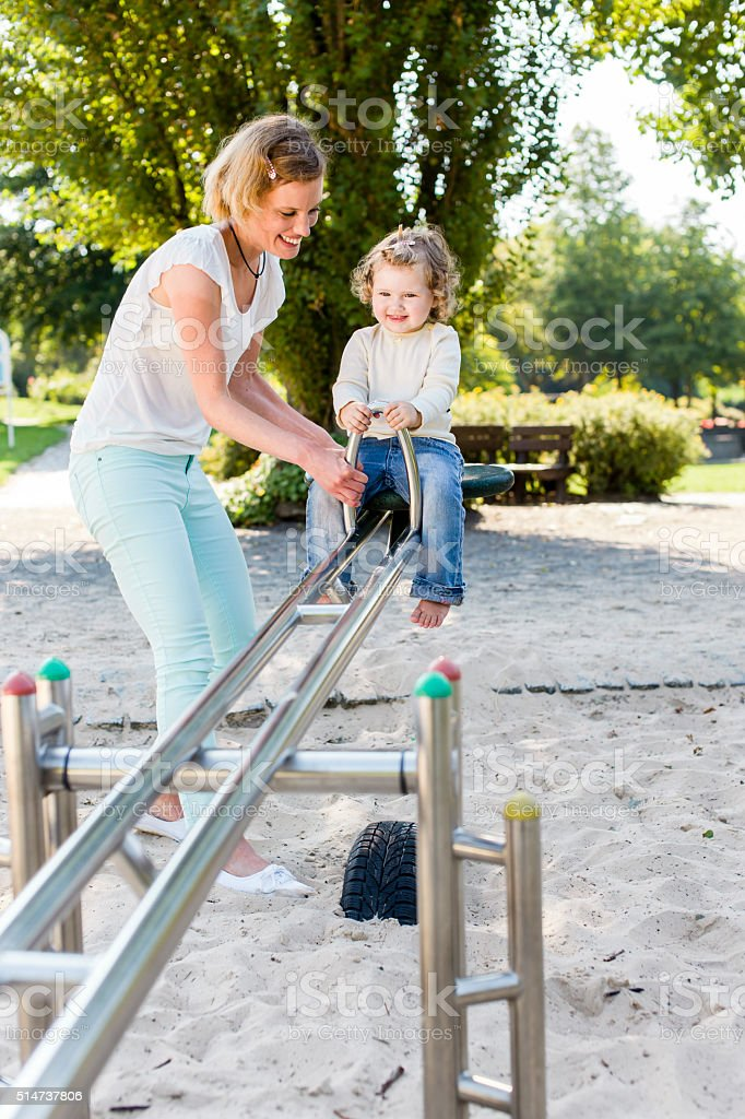 On the playground, seesaw stock photo