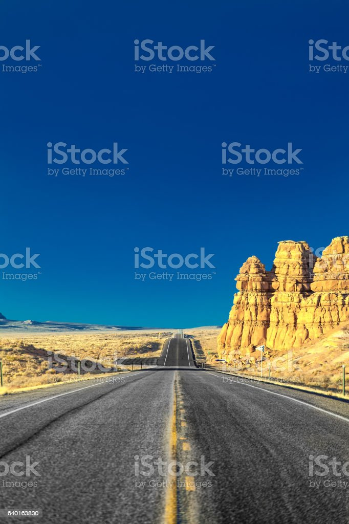 on the road in the desert of rocks stock photo