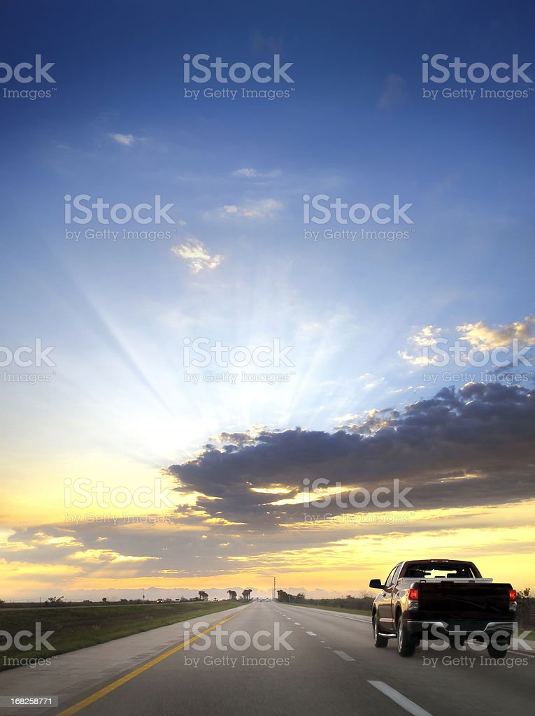 on the road over sunset stock photo