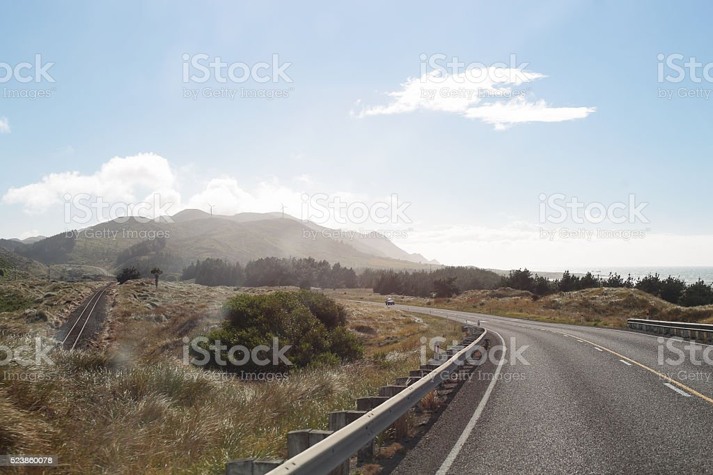 On The Road with Location mountain on highway in NewZealand stock photo