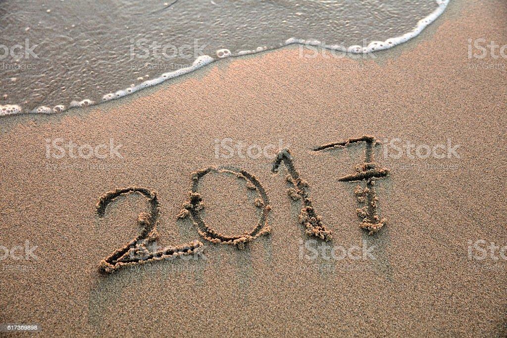 2017 on the sandy beach stock photo