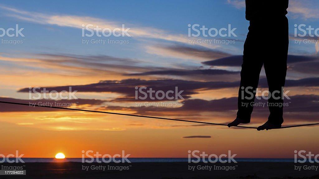 on the slackline in sunrise royalty-free stock photo
