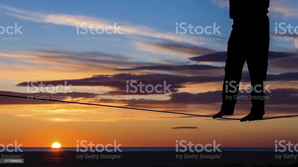 on the slackline in sunrise stock photo