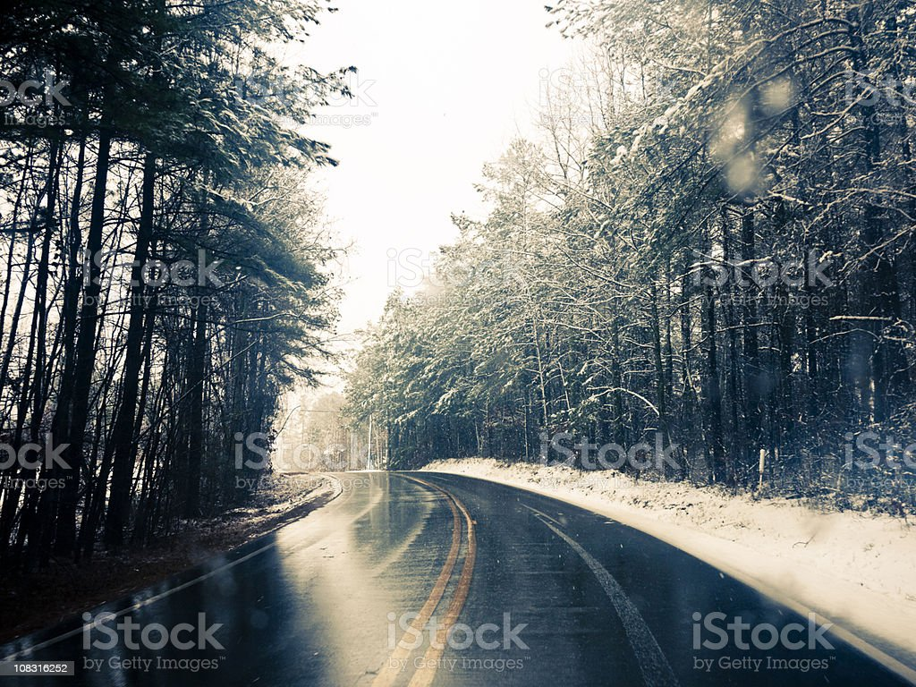 on the snowy road stock photo