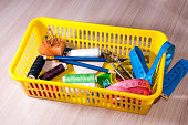 On the table is a basket of tools for sewing