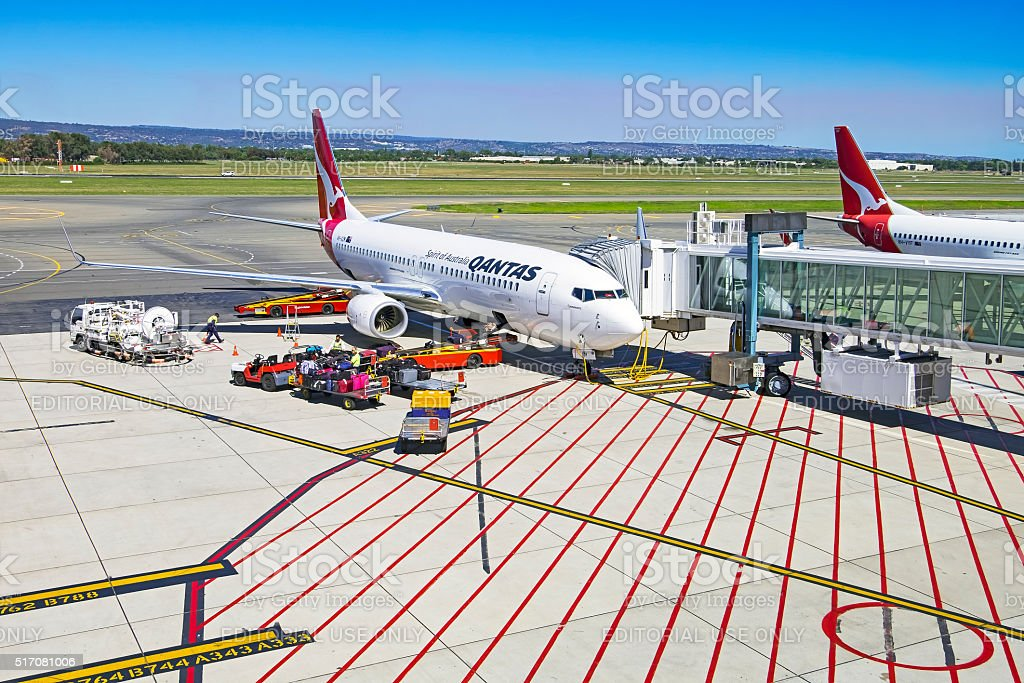 On the tarmac, Qantas aircraft being prepared for next flight stock photo