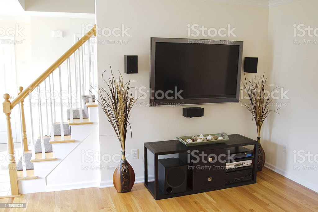 TV on the wall with a modern home theater system stock photo
