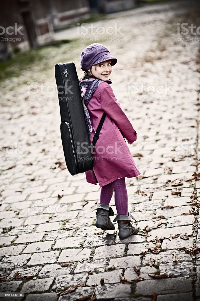 On the way to violin lesson royalty-free stock photo