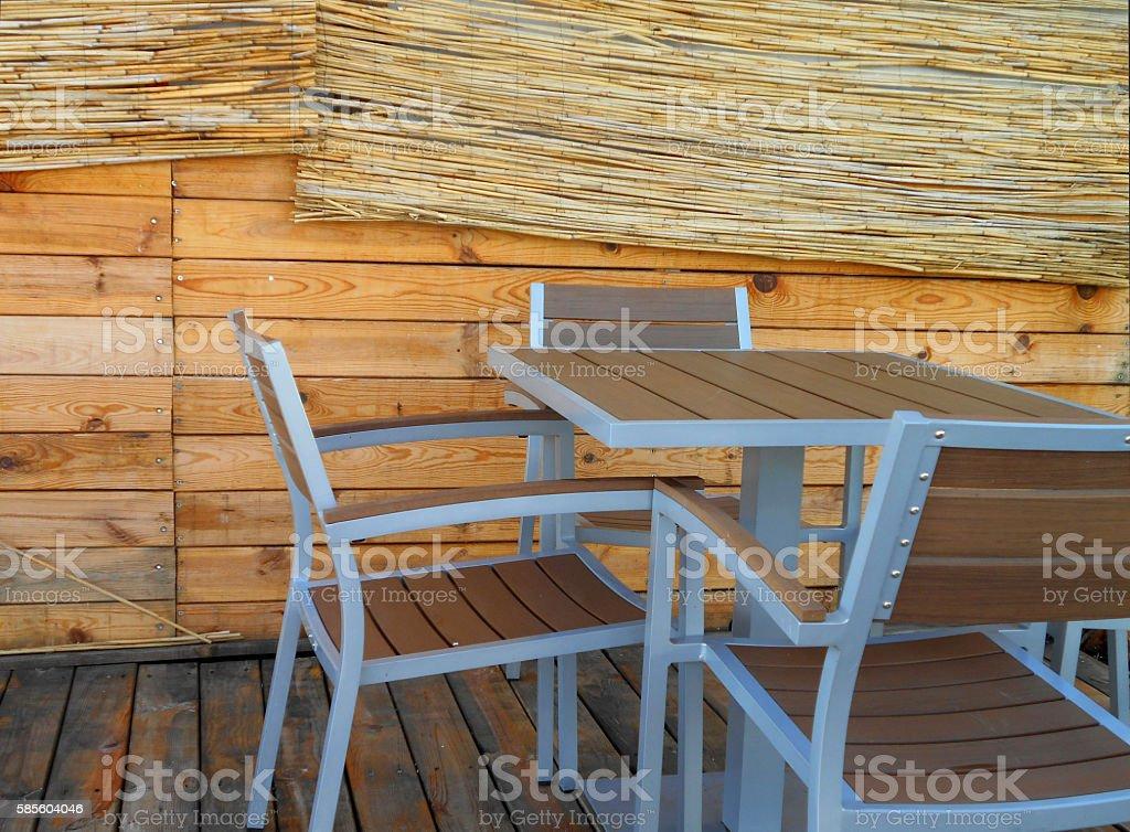 On the wooden hut's terrace stock photo
