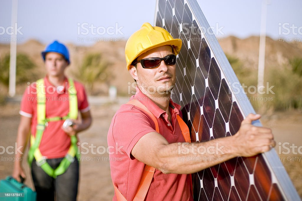 On their way to install a solar panel royalty-free stock photo