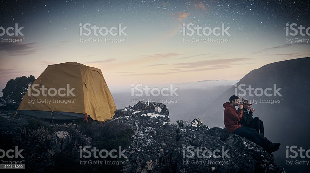 On top of mountains and beneath the stars stock photo
