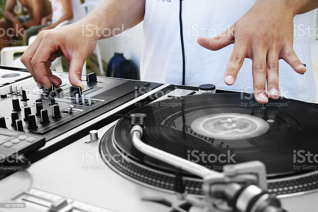 DJ on turntable stock photo
