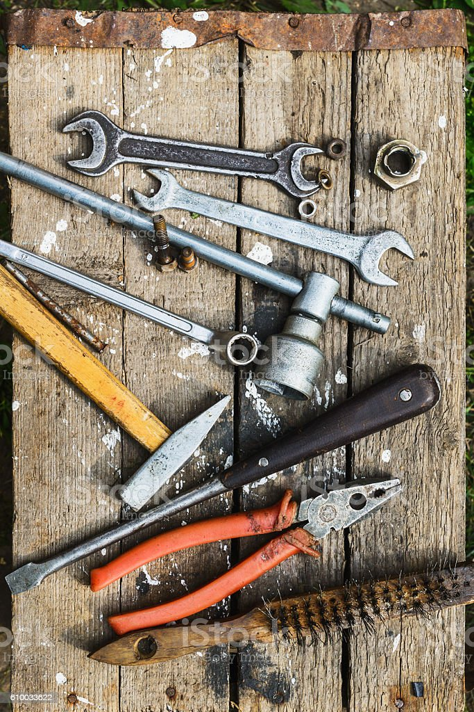 On weathered old wooden surface lie the  tools stock photo