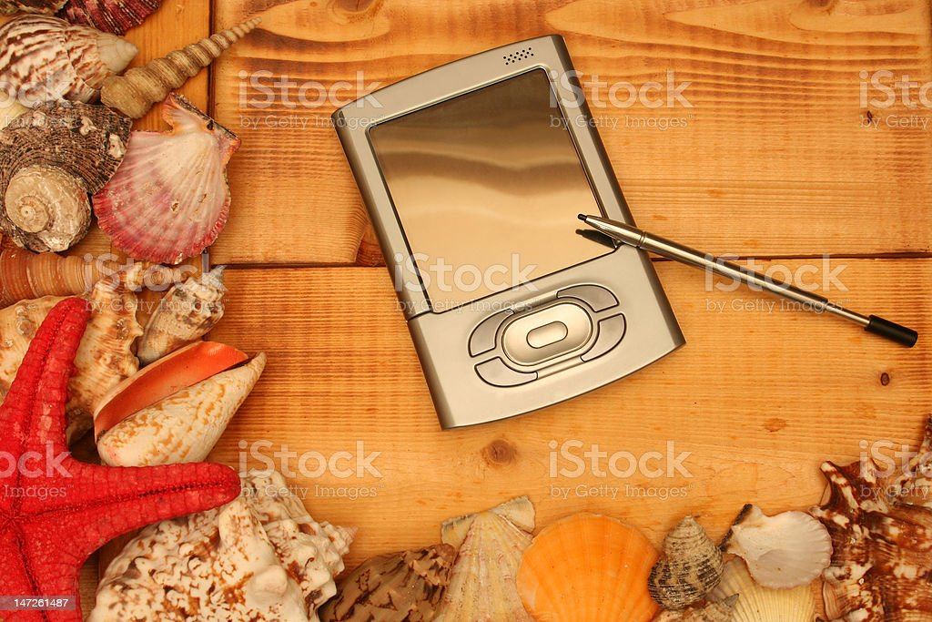 PDA on wood royalty-free stock photo