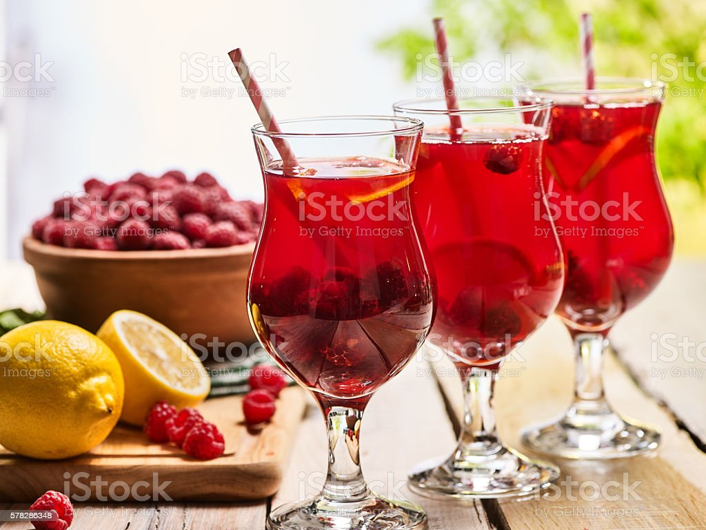 On wooden are ice cold beverage glasses with berries cocktail . stock photo