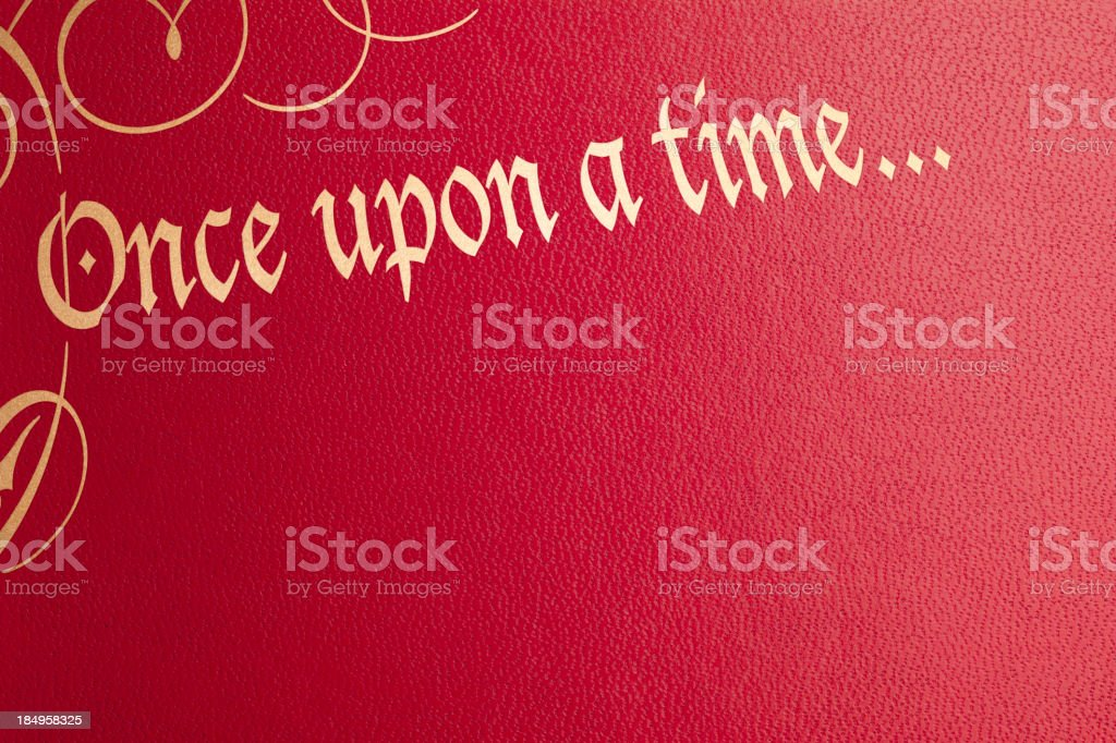 Once upon a time red leather book cover stock photo