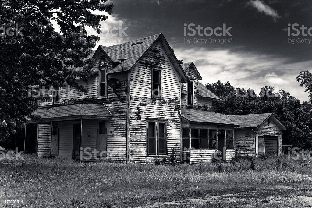 Once-beautiful home stands abandoned royalty-free stock photo