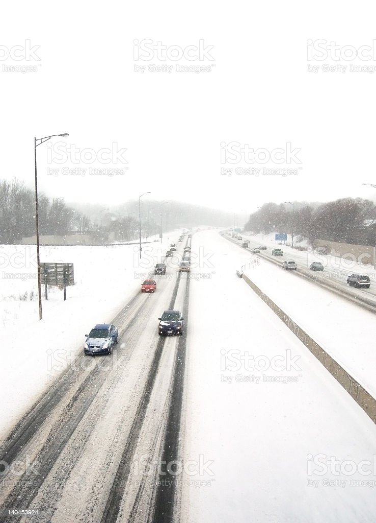 Oncoming traffic in a snowstorm royalty-free stock photo