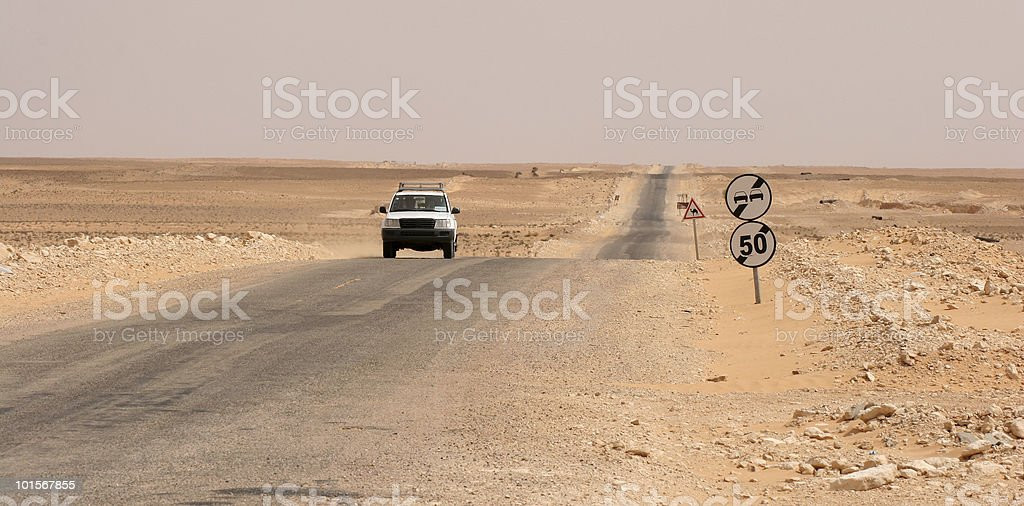 One 4x4 Jeep in Tunisian desert, between Tataouine and Douz stock photo