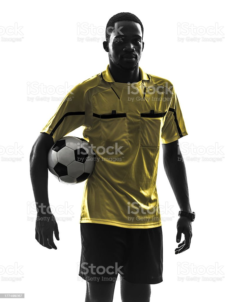 one african man referee standing holding football silhouette royalty-free stock photo