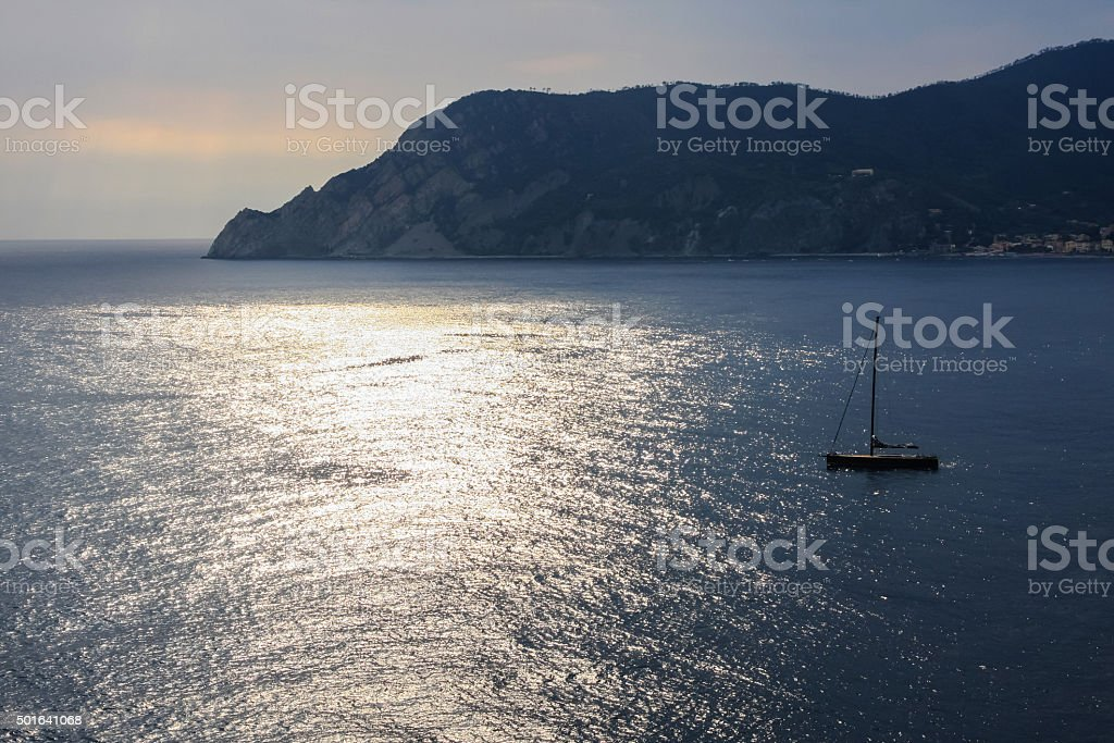 One alone sailing boat in Vernazza stock photo