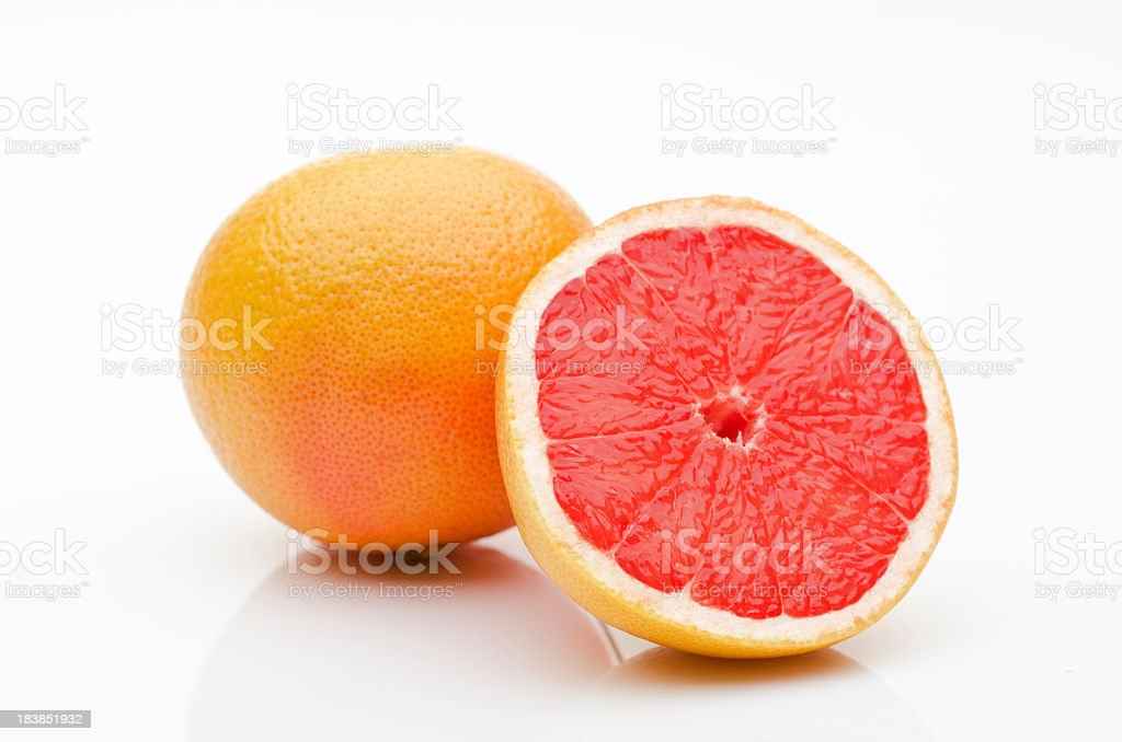 One and a half grapefruits on a white background stock photo