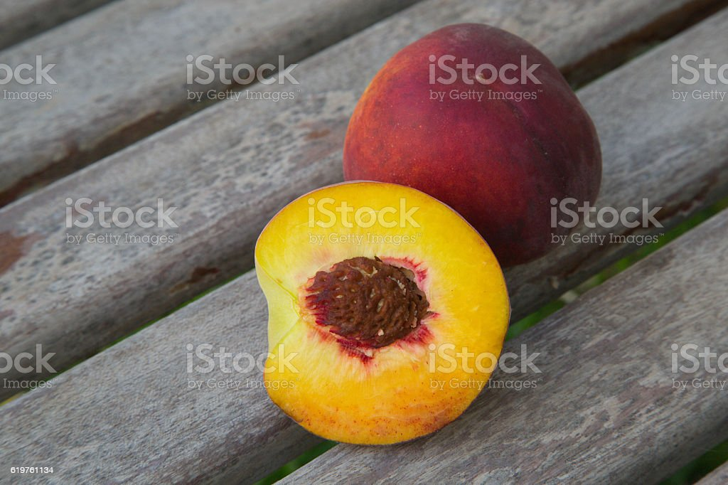 One and a half peach stock photo