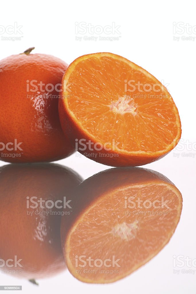 One and a half Tangerine royalty-free stock photo