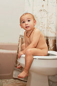 One and Half Year Baby Girl on Toilet
