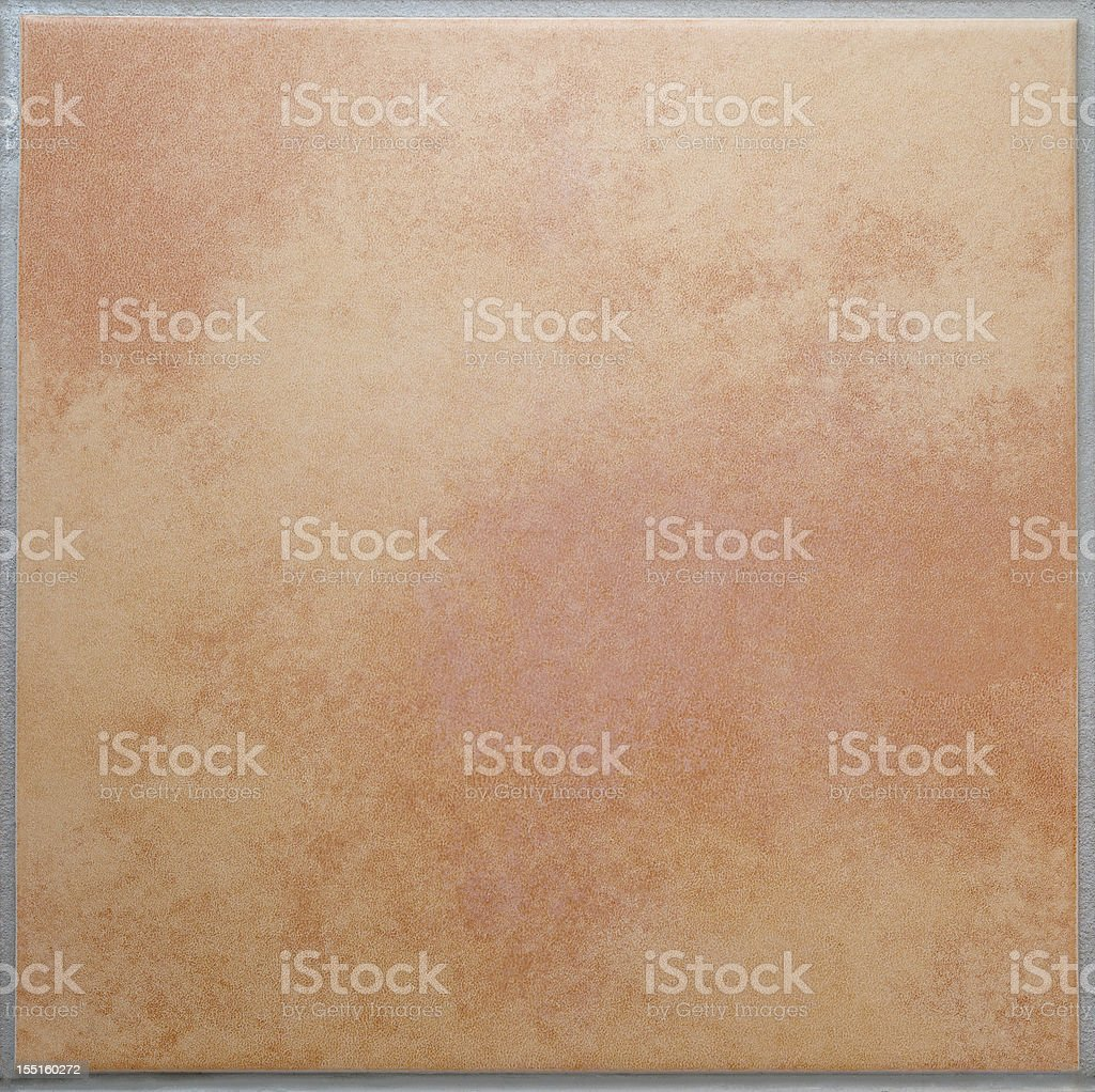 One apricot colored terracotta tile isolated background XL stock photo