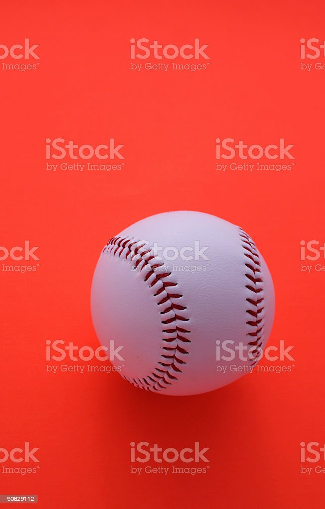 One Baseball Ball on red background royalty-free stock photo