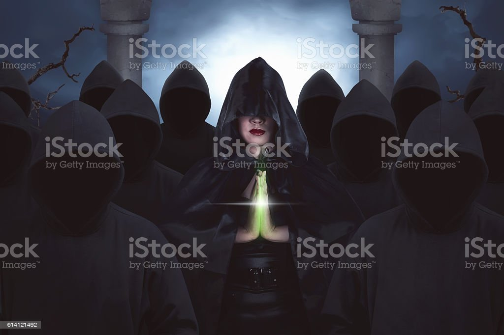 One beautiful asian witches praying in the night forest stock photo