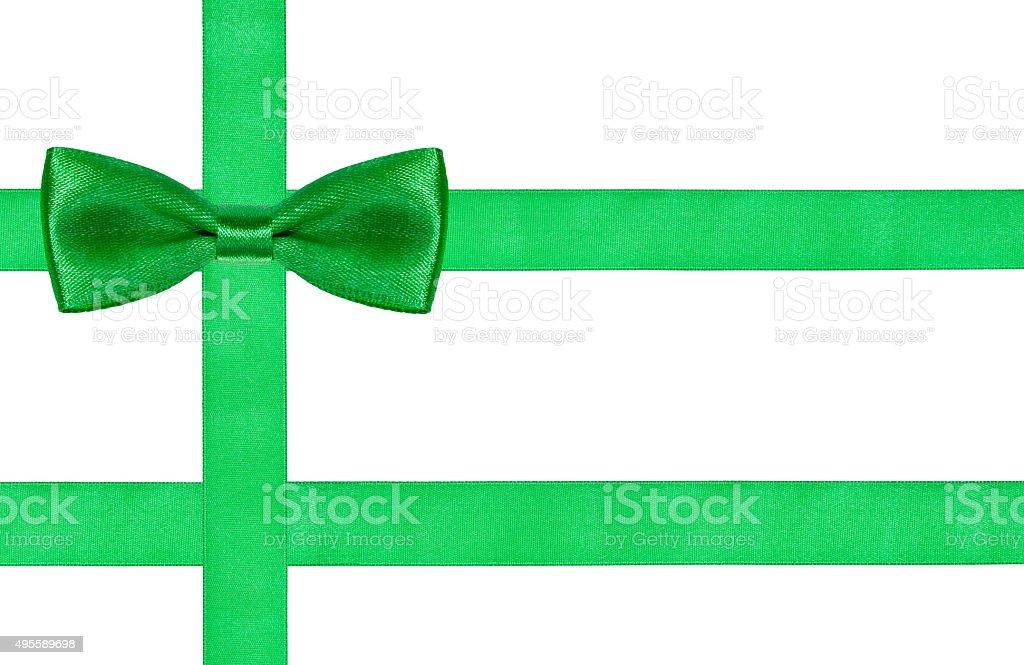 one big green bow knot on three satin strips stock photo
