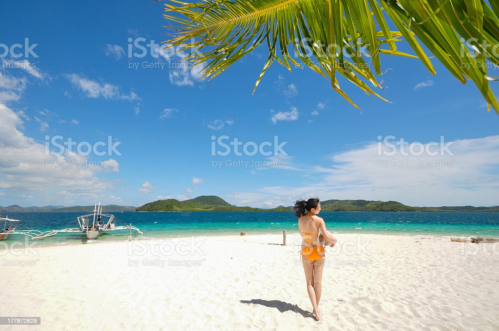 one bikini girl holds coconut on white beach royalty-free stock photo