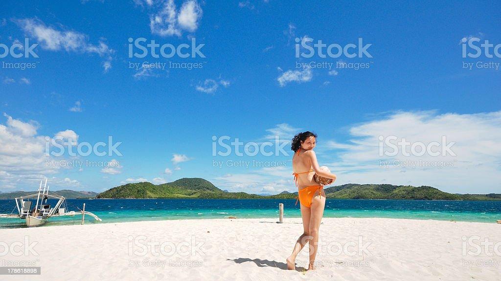 one bikini girl holds coconut on white beach royalty-free stock photo