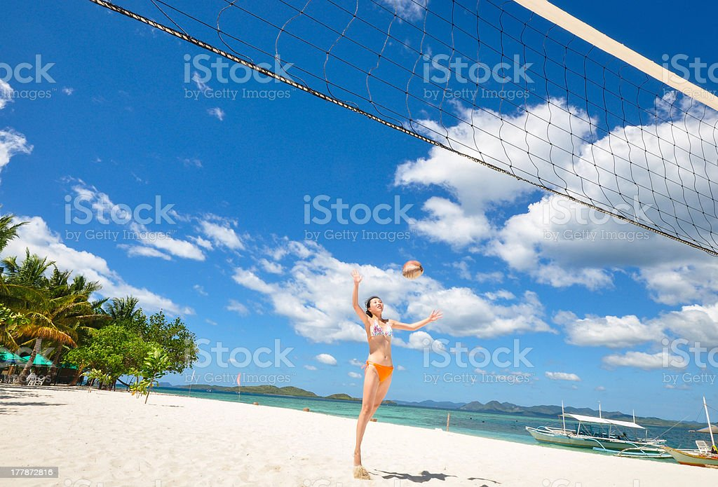 one bikini girl playing volleyball on white beach royalty-free stock photo