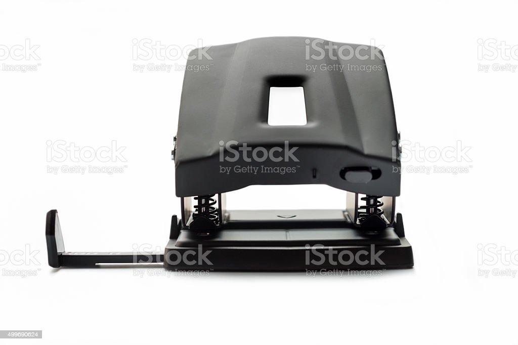 one black hole puncher isolated on white background stock photo