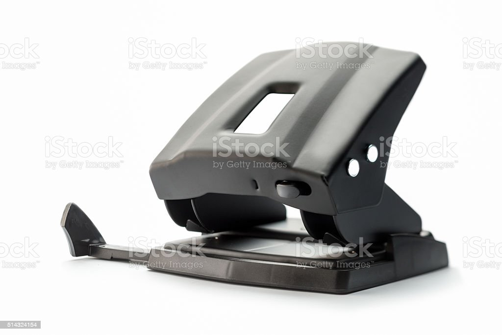 one black hole puncher isolated on white background stock photo