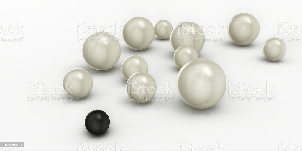 One Black Pearl among Many White Pearls stock photo