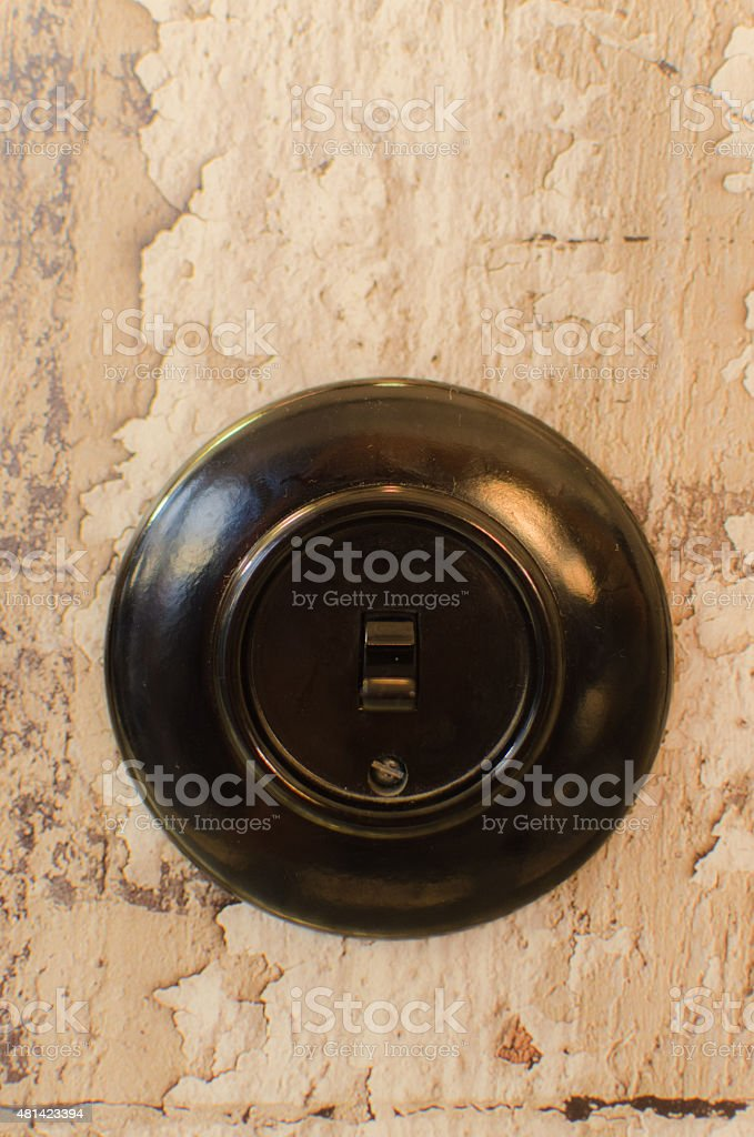 One black switch on a wall stock photo