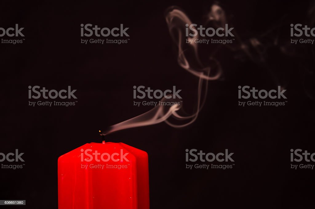one blown out candle stock photo