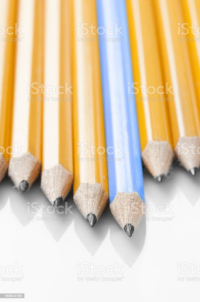 One blue pencils stands out from the yellow ones royalty-free stock photo