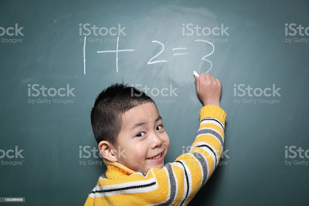 one boy is doing the math question royalty-free stock photo