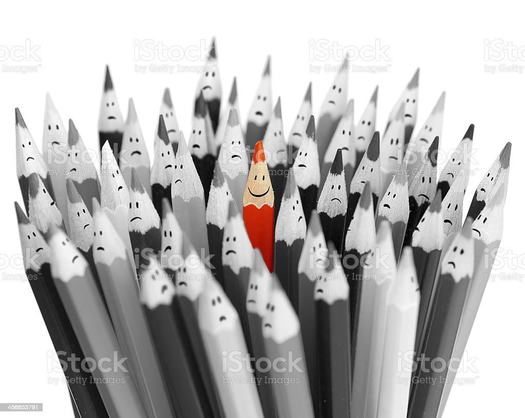 One bright color smiling pencil among bunch sad pencils stock photo
