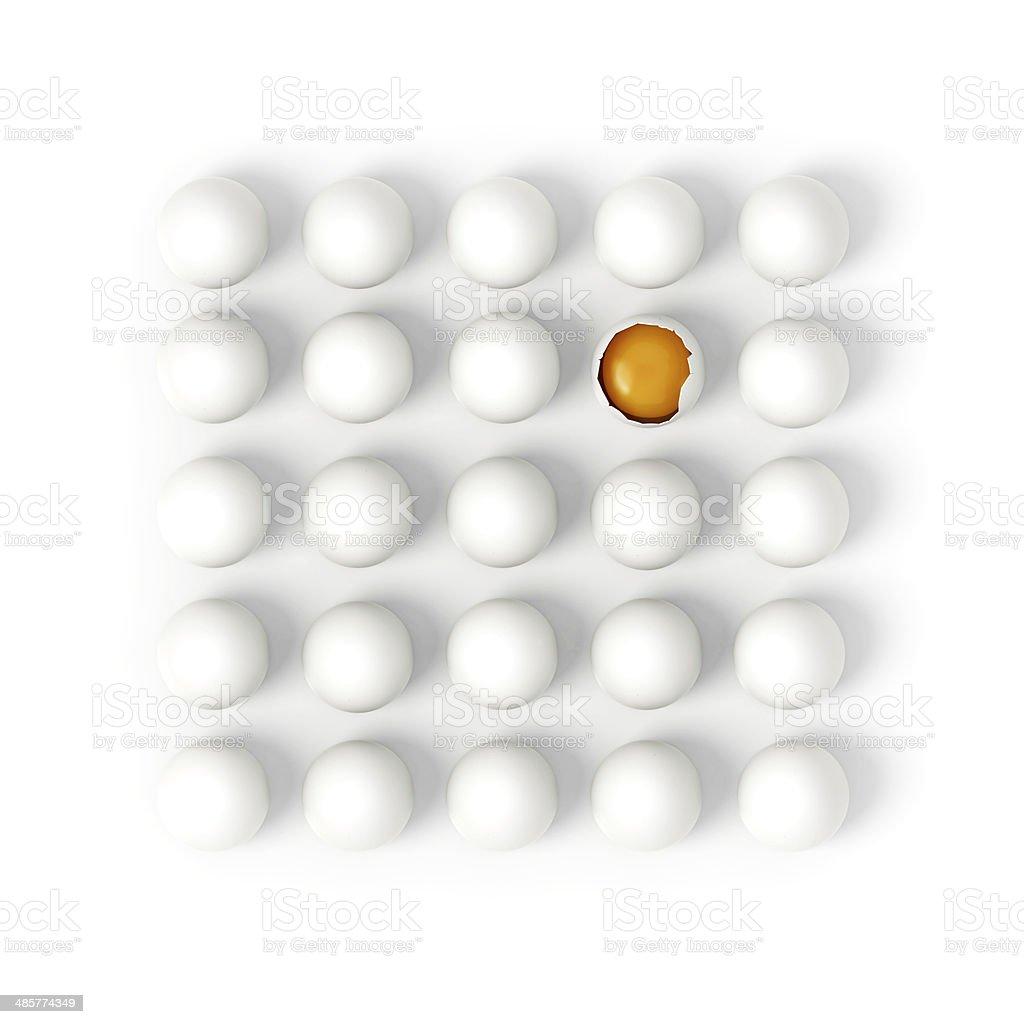 One broken egg in rows of white eggs stock photo