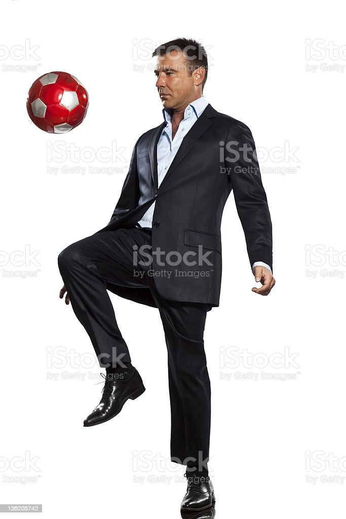 one business man playing juggling soccer ball royalty-free stock photo