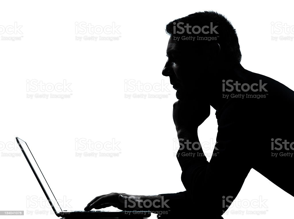 one business man silhouette computing computer laptop serious stock photo
