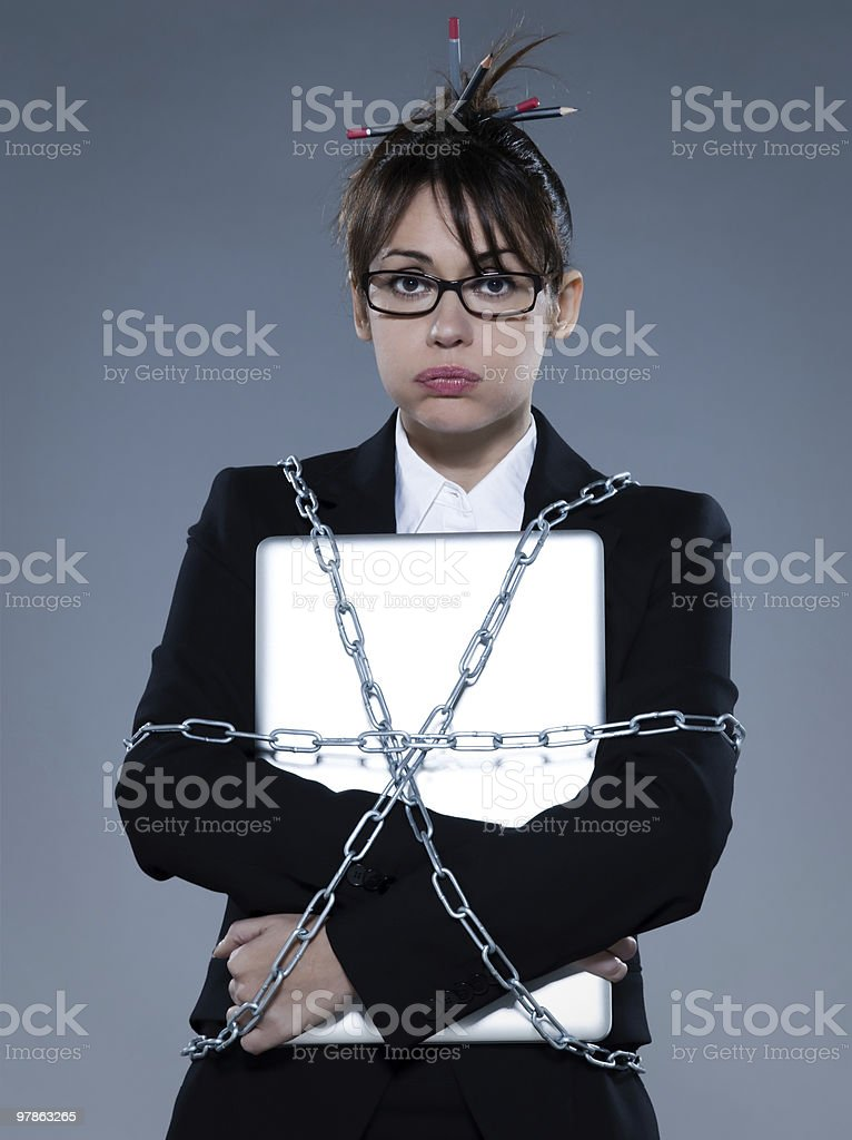 one business woman chained to laptop computer royalty-free stock photo