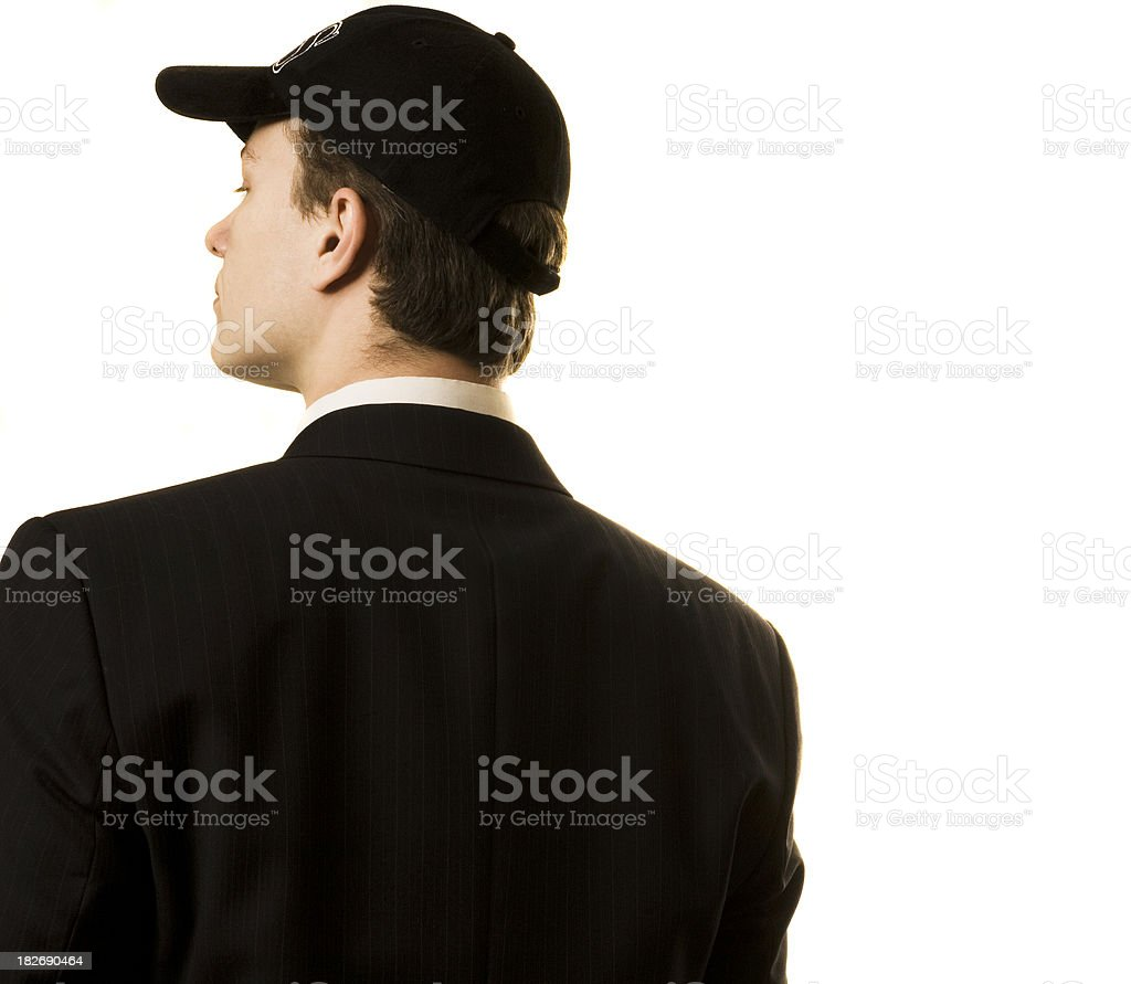 One Caucasian business male back partially to the camera wearing royalty-free stock photo