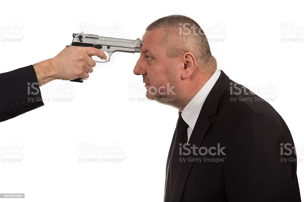 one caucasian businessman with gun pointing to his head stock photo